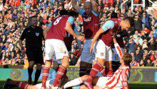 West Ham United's Winston Reid challenges Stoke City's Peter Crouch after a foul by Peter Crouch on Matthew Taylorduring the Barclays Premier League match at the Britannia Stadium, Stoke.