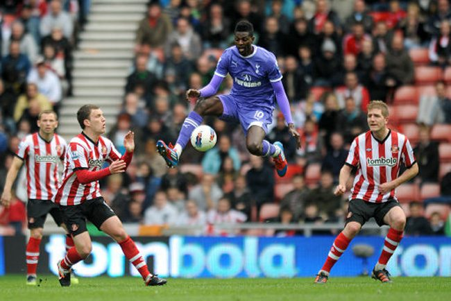 Tottenham Hotspur's Emmanuel Adebayor (centre) in action against Sunderland