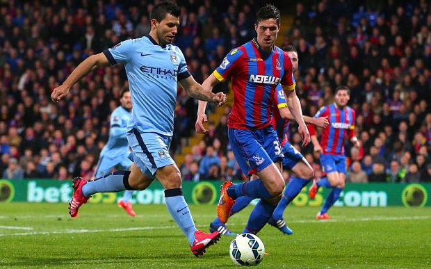 Editorial use only. No merchandising. For Football images FA and Premier League restrictions apply inc. no internet/mobile usage without FAPL license - for details contact Football Dataco Mandatory Credit: Photo by Kieran McManus/BPI/REX (4610844i) Sergio Aguero of Manchester City takes on Martin Kelly of Crystal Palace Barclays Premier League 2014/15 Crystal Palace v Manchester City Selhurst Park Stadium, Whitehorse Ln, London, United Kingdom - 6 Apr 2015