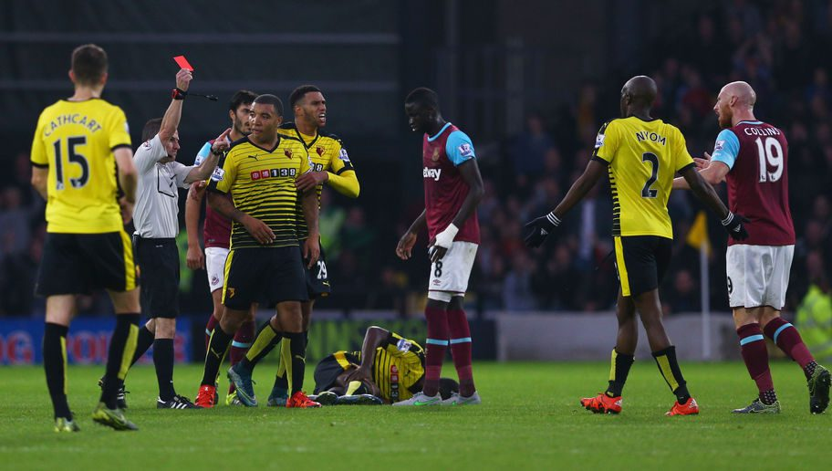WATFORD, ENGLAND - OCTOBER 31: James Collins (1st R) of West Ham United is shown a red card by referee Keith Stroud (2nd L) during the Barclays Premier League match between Watford and West Ham United at Vicarage Road on October 31, 2015 in Watford, England. (Photo by Harry Engels/Getty Images)